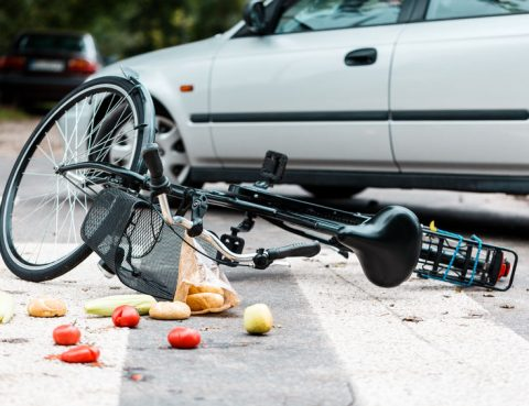 Crashed bicycle laying in the street