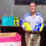 Craig Goldenfarb with Surfside donations